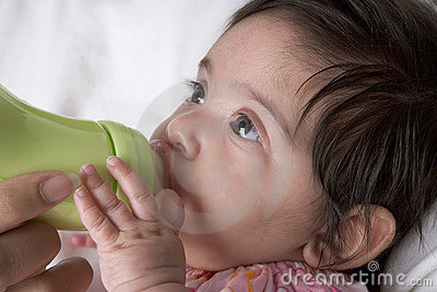 Baby drinks from baby-bottle