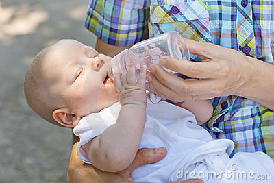 Baby drinks water from bottle