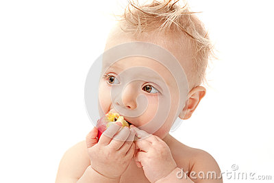 Baby eating apple