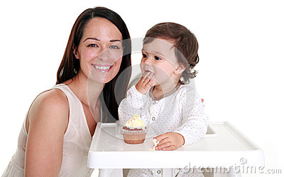 Baby eating cake with mum