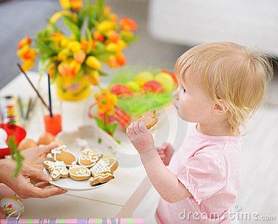 Baby eating Easter cookies