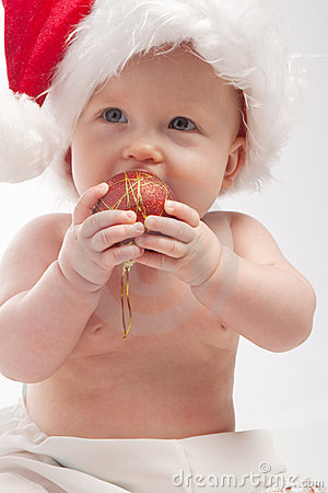 Baby eating red Xmas ball