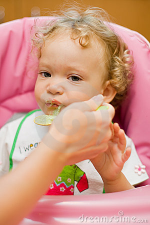 Baby eating spinach