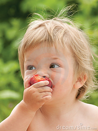 Baby eating strawberry