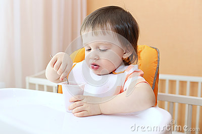 Baby eating youghourt