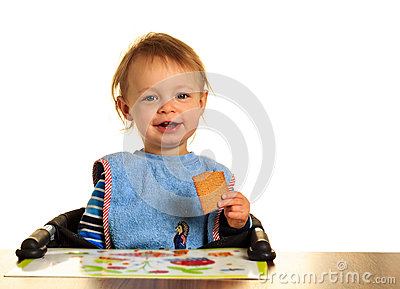 Baby eats a biscuit