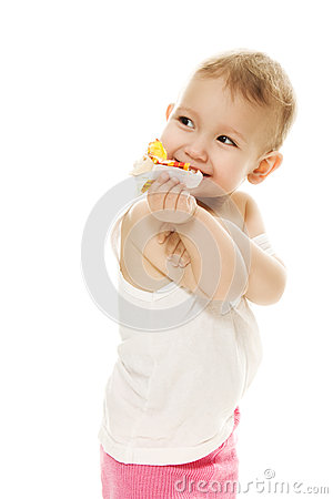 Baby eats candy on a white background