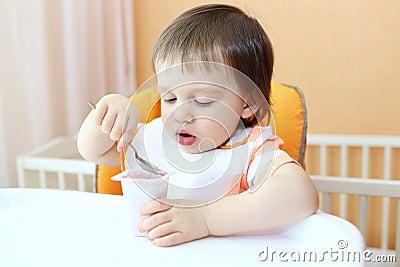 Baby eats youghourt