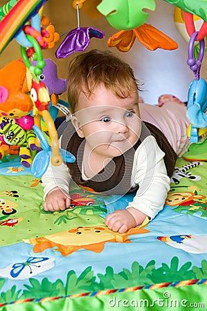 Baby in educational mat