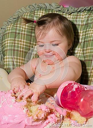 Baby Enjoying her first birthday cake.