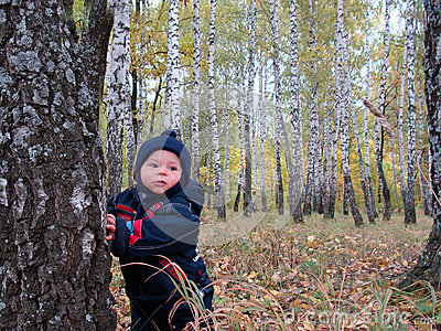 Baby in fall forest