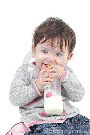 Baby with a feeding bottle in her mouth