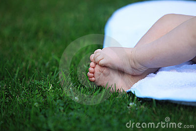 Baby feet on meadow