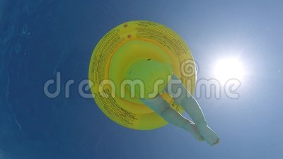 Baby float in summer swimming pool. Baby float ring in summer swimming pool with sun in background stock video footage