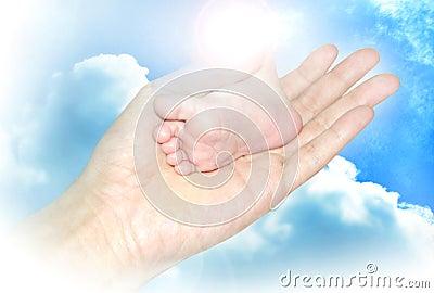 Baby foot in hand