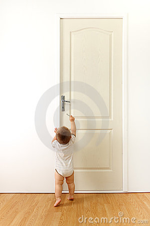 Baby in front of door