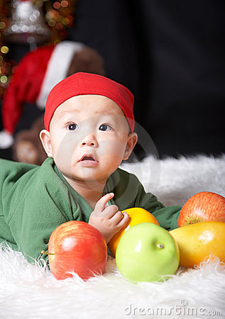 Baby and fruits