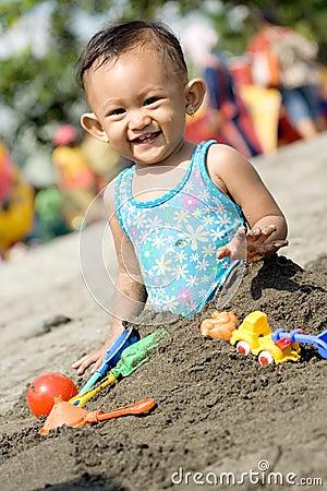 Baby fun play at the beach