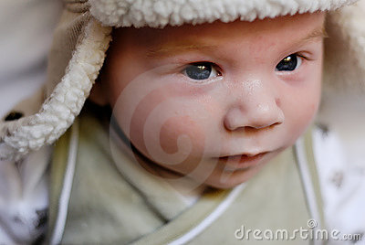 Baby in fur lined hat