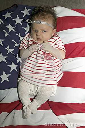 Baby  girl on  American flag Editorial Photography