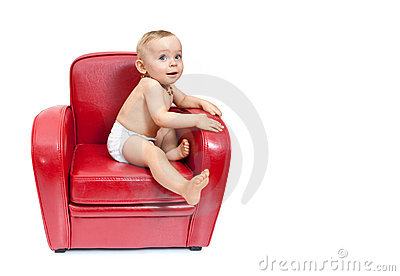 Baby girl on an armchair.