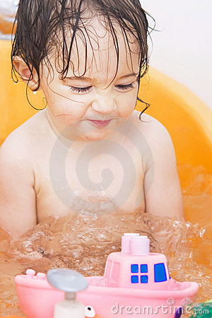 Baby girl in bath