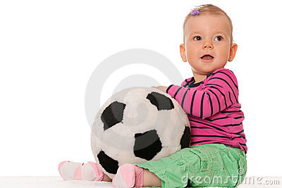 Baby girl with a big toy ball