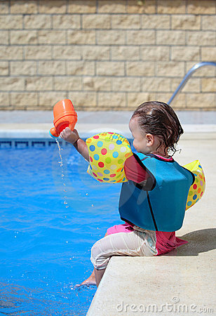 Free Baby Girl By Swimming Pool Royalty Free Stock Photos - 2965258