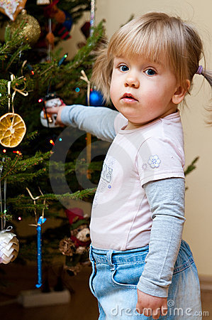 Baby girl with Christmas tree