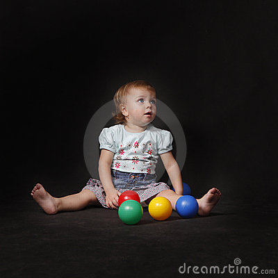 Baby girl with color  balls