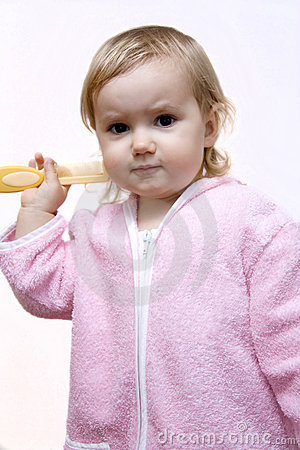 Baby girl combing hair