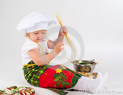 Baby girl in the cook hat