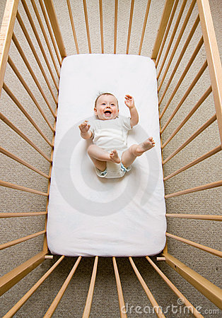 Baby girl in a crib
