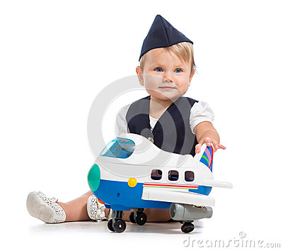 Baby girl dressed as stewardess with air plane toy