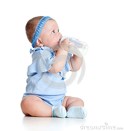 Baby girl drinking milk from bottlee without help