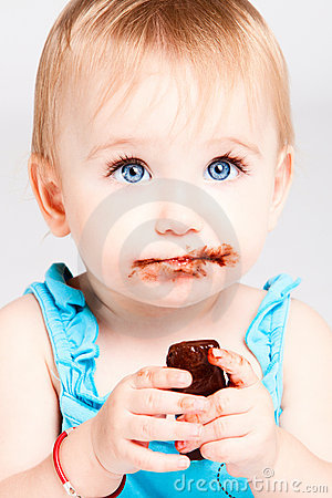 Baby girl eat chocolate