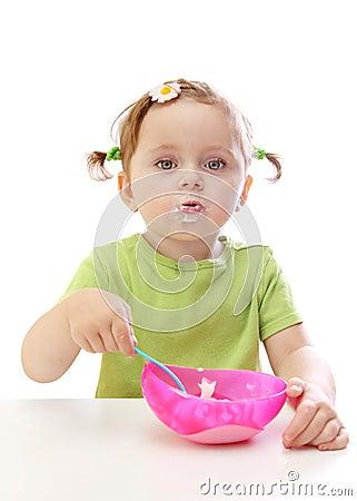 Baby girl eating yoghurt