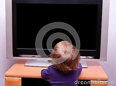 Baby girl in front of TV