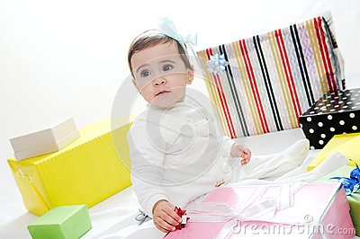 Baby girl with gifts. Isolated on white background