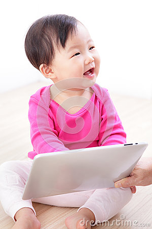 Baby girl happy play tablet PC