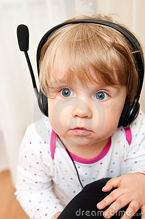 Baby girl in headphones