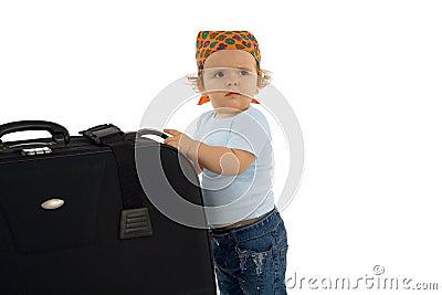 Baby girl with huge luggage