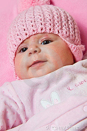 Free Baby Girl Is Wearing A Pink Hat Stock Photo - 23098750