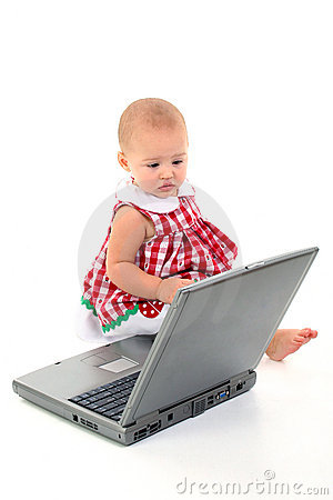 Baby Girl With Laptop Computer Over White