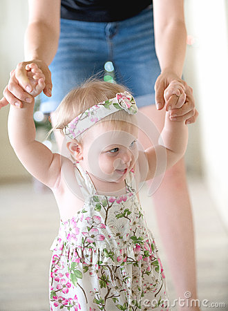 Free Baby Girl Learning To Walk Royalty Free Stock Photo - 66446285