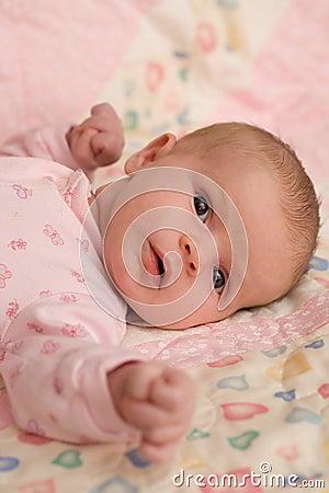 Baby Girl Lying on Blanket