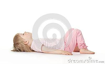 The baby girl is lying on the floor