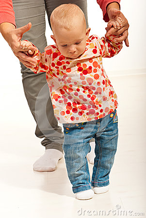 Baby girl making first steps