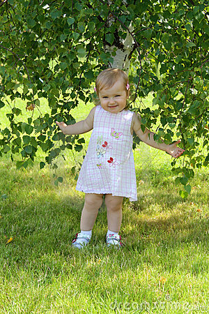 Baby girl near the birch