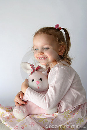 Baby girl and pink bunny